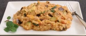 Orientalischer Hirsetopf mit Aubergine, Zucchini, Karotten und Kichererbsen